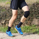 cross-country runner during the race with his knee wrapped by a